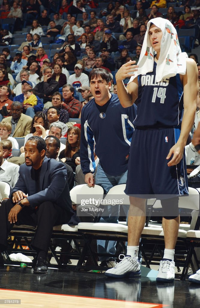 Owner Mark Cuban (middle) of the Dallas Mavericks yells from behind the bench as Eduardo Najera #14 looks on during the game against the Memphis Grizzlies at The Pyramid on November 15, 2003 in Memphis, Tennessee. The Grizzlies won in overtime 108-101.