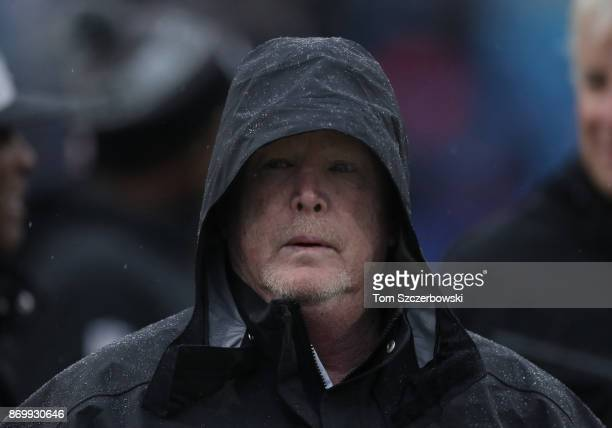 Owner Mark Davis of the Oakland Raiders watches pregame warmups before the start of NFL game action against the Buffalo Bills at New Era Field on...
