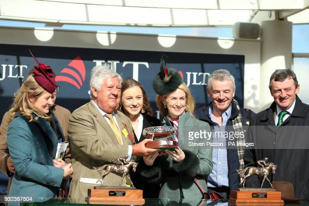 Owner Michael O'Leary and winnnig connections collect the trophy after winning the JLT Novices' Chase with horse Shattered Love during St Patrick's...
