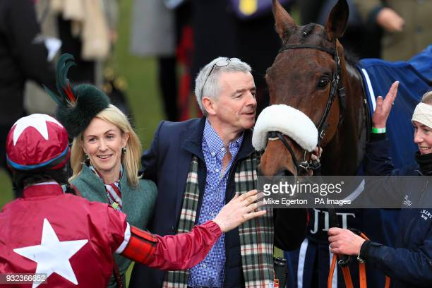 Owner Michael O'Leary celebrates with horse Shattered Love after winning the JLT Novices' Chase during St Patrick's Thursday of the 2018 Cheltenham...