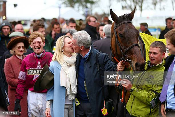 Owner Michael O'Leary kisses his wife Anita O'Leary as David Mullins smiles in the Winners' Enclosure after riding Rule The World to victory in the...