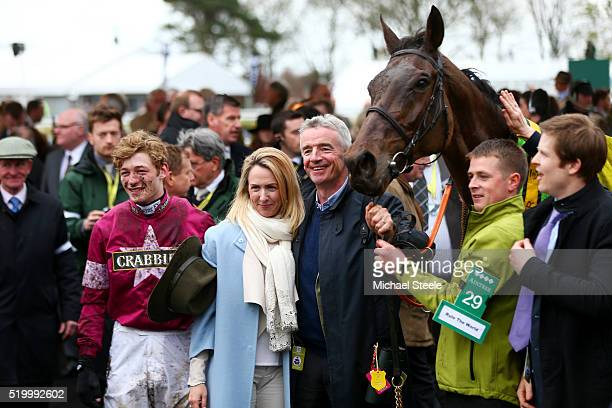 Owner Michael O'Leary poses with his wife Anita O'Leary and David Mullins in the Winners' Enclosure after Rule The World won the 2016 Crabbie's Grand...