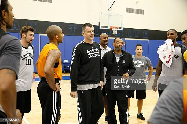 Owner Mikhail Prokhorov and Head Coach Lionel Hollins of the Brooklyn Nets addresses the team during preseason training camp at Duke University on...