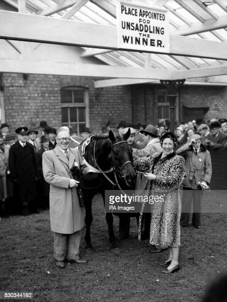 Owner Mrs Leonard Carver pictured with her husband pats her horse ESB after winning the Grand National Handicap Steeplechase at Aintree Liverpool It...