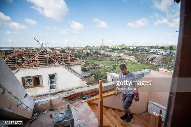 Owner of a destroyed house coming to what used to be an attic on June 26, 2021 in Mikulice, Czech Republic. A massive tornado swept through the...