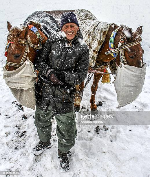 """Owner of a horse drawn sleigh pose on the ice over the """"Lake Cildir"""", country's eastern Anatolia Region's 2nd largest lake with 123 square kilometers..."""