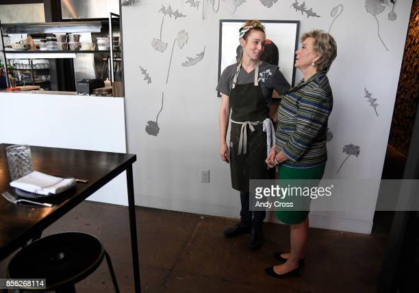 Owner of Annette restaurant Caroline Glover left talks with Small Business Association administrator Linda McMahon inside her restaurant at the...