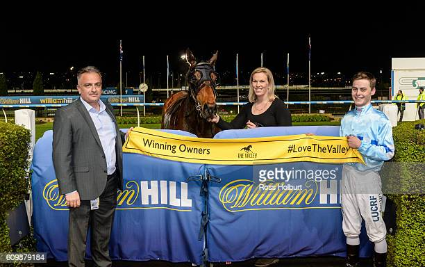 Owner of Ballinaclash Bill Aidonis with Jack Martin and Amy Johnston after winning Simpson Construction Handicap at Moonee Valley Racecourse on...