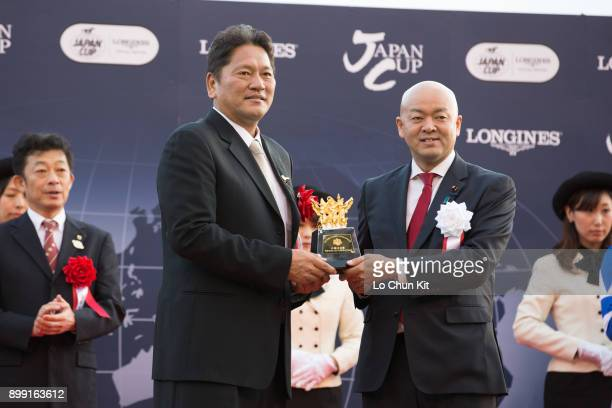 Owner of Cheval Grand, Kazuhiro Sasaki receives the Japan Cup souvenir during the Japan Cup presentation ceremony at Tokyo Racecourse on November 26,...