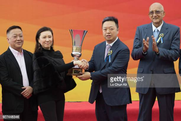 Owner of Felizmaster receives the trophy after winning Race 6 Chairman's Challenge Cup during Macau Hong Kong Trophy Day at Taipa Racecourse on March...