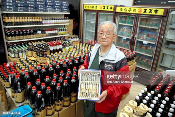 Owner of fishery shop 'Suzuki' Yuzuru Suzuki younger brother of Nobel Prize laureate Akira Suzuki poses for photographs a week after the magnitude 67...
