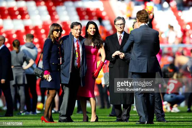 Owner of Liverpool John Henry walks on the pitch with girlfriend Linda Pizzuti after the Premier League match between Liverpool FC and Wolverhampton...