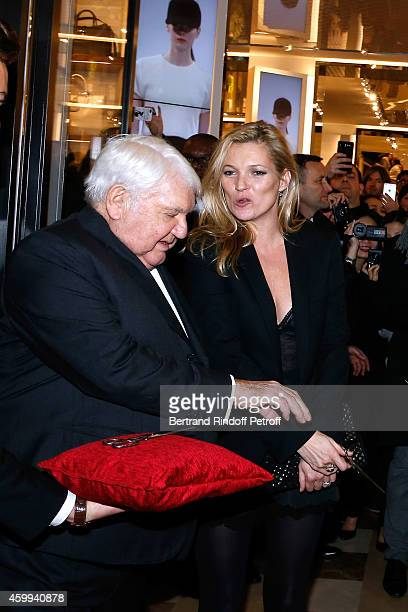 Owner of Longchamp Philippe Cassegrain and Model Kate Moss attend the Longchamp Elysees 'Lights On Party' Boutique Launch on December 4 2014 in Paris...