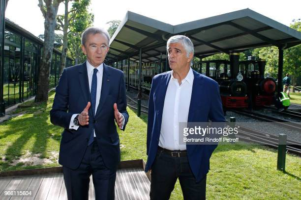Owner of LVMH Luxury Group Bernard Arnault and General manager of LVMH Antonio Belloni attend the Inauguration of the new Jardin D'Acclimatation on...