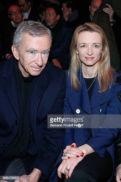 Owner of LVMH Luxury Group Bernard Arnault and his daughter Louis Vuitton's executive vice president Delphine Arnault attend the Dior Homme Menswear...