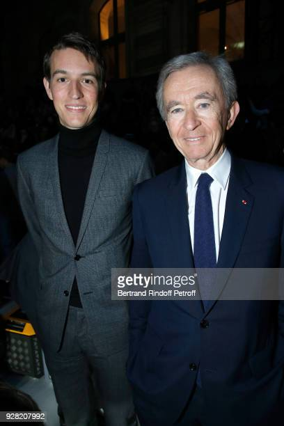 Owner of LVMH Luxury Group Bernard Arnault and his son CEO of Rimowa Alexandre Arnault attend the Louis Vuitton show as part of the Paris Fashion...