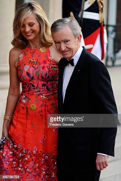 Owner of LVMH Luxury Group Bernard Arnault and his wife arrive at the Elysee Palace for a State dinner in honor of Queen Elizabeth II hosted by...
