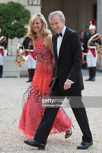 Owner of LVMH Luxury Group Bernard Arnault and his wife Helene Arnault arrive at the Elysee Palace for a State dinner in honor of Queen Elizabeth II...