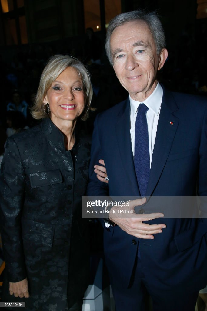 Owner of LVMH Luxury Group Bernard Arnault and his wife Helene Arnault attend the Louis Vuitton show as part of the Paris Fashion Week Womenswear Fall/Winter 2018/2019 on March 6, 2018 in Paris, France.