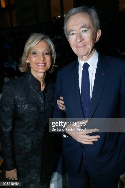 Owner of LVMH Luxury Group Bernard Arnault and his wife Helene Arnault attend the Louis Vuitton show as part of the Paris Fashion Week Womenswear...