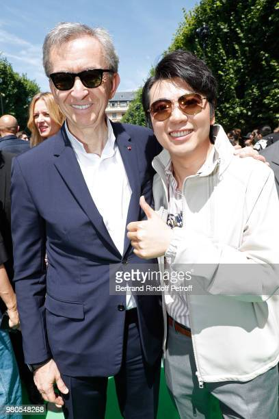 Owner of LVMH Luxury Group Bernard Arnault and Pianist Lang Lang attends the Louis Vuitton Menswear Spring/Summer 2019 show as part of Paris Fashion...