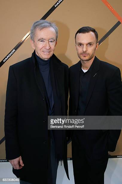 Owner of LVMH Luxury Group Bernard Arnault and Stylist Kris Van Assche pose backstage after the Dior Homme Menswear Fall/Winter 20172018 show as part...