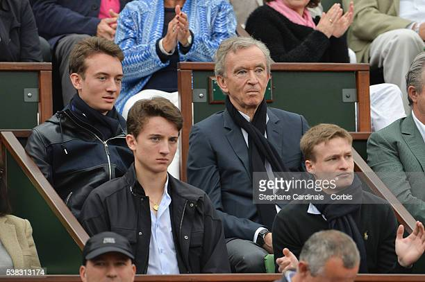 Owner of LVMH Luxury Group Bernard Arnault his sons Frederic Jean and guest attend the French Tennis Open Day Fifteen with the Final between Novak...
