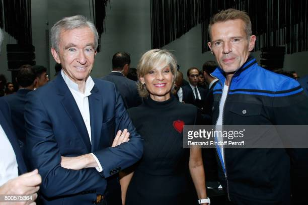 Owner of LVMH Luxury Group Bernard Arnault his wife Helene MercierArnault and actor Lambert Wilson attend the Dior Homme Menswear Spring/Summer 2018...