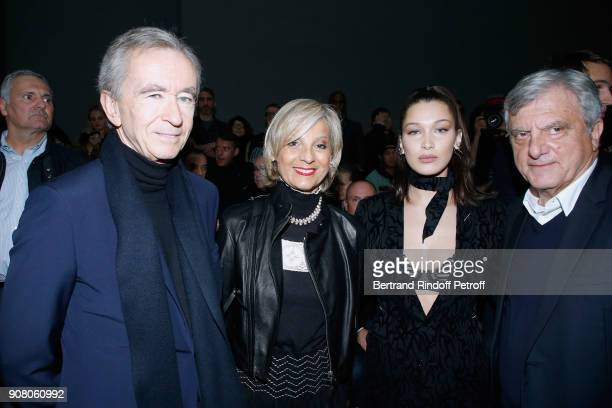 Owner of LVMH Luxury Group Bernard Arnault his wife Helene MercierArnault Model Bella Hadid and Outgoing CEO of Dior Sidney Toledano attend the Dior...
