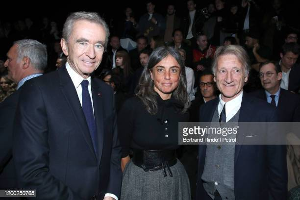 Owner of LVMH Luxury Group Bernard Arnault , Jean-Michel Signoles and his wife Laurence Signoles attend the Dior Homme Menswear Fall/Winter 2020-2021...