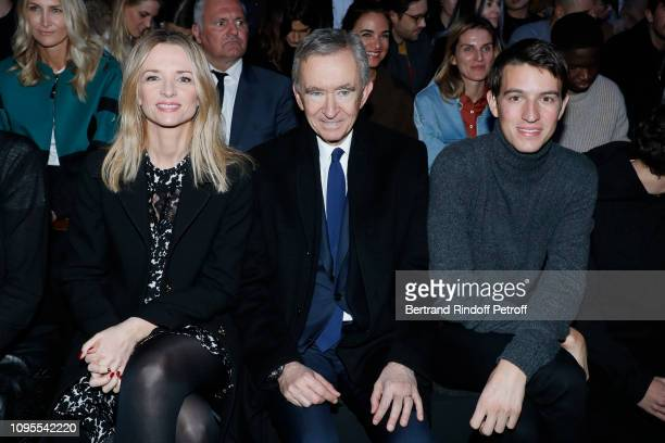 Owner of LVMH Luxury Group Bernard Arnault sitting between his daughter Louis Vuitton's executive vice president Delphine Arnault and his son CEO of...