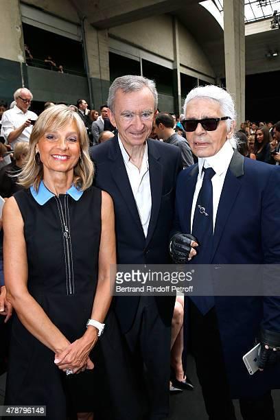 Owner of LVMH Luxury Group Bernard Arnault standing between his wife Helene Arnault and Fashion Designer Karl Lagerfeld attend the Dior Homme...
