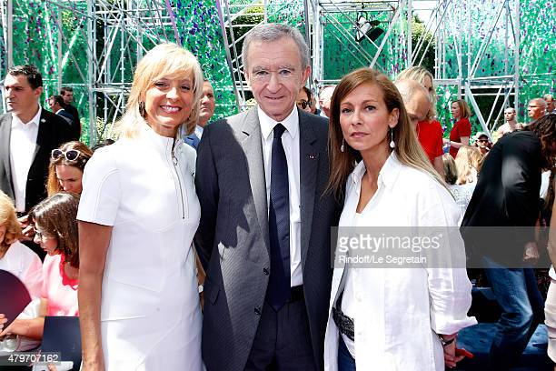 Owner of LVMH Luxury Group Bernard Arnault standing between his wife Helene Arnault and Miss Manuel Valls, Violonist Anne Gravoin attend the...