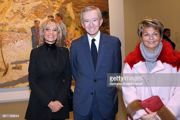 Owner of LVMH Luxury Group Bernard Arnault standing between his wife Helene Arnault and Baroness Myriam Ullens de Schooten attend the 'Bentu'...