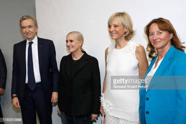 Owner of LVMH Luxury Group Bernard Arnault, Stylist Maria Grazia Chiuri, Helene Arnault and politician Segolene Royal pose after the Christian Dior...