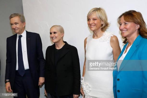 Owner of LVMH Luxury Group Bernard Arnault Stylist Maria Grazia Chiuri Helene Arnault and politician Segolene Royal pose after the Christian Dior...