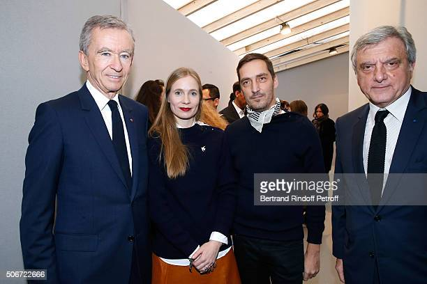 Owner of LVMH Luxury Group Bernard Arnault Stylists Lucie Meier Serge Ruffieux and CEO Dior Sidney Toledano attend the Christian Dior Spring Summer...