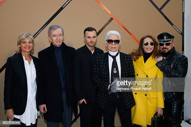 Owner of LVMH Luxury Group Bernard Arnault with his wife Helene Arnault Stylist Kris Van Assche stylist Karl Lagerfeld Marisa Berenson and Peter...