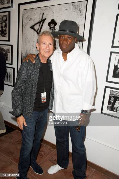 Owner of Mr Musichead Sam Milgrom and Vince Wilburn Jr attend the VIP Reception for Chris Cuffaro's New Exhibit 'Greatest Hits Martini Ranch' at Mr...
