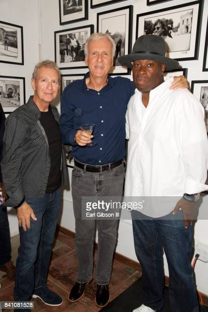 Owner of Mr Musichead Sam Milgrom filmmaker James Cameron and Vince Wilburn Jr attend the VIP Reception for Chris Cuffaro's New Exhibit 'Greatest...
