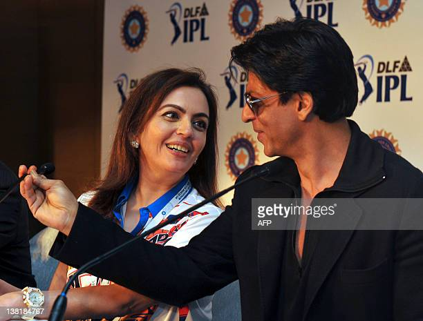 Owner of Mumbai Indians Neeta Ambani and Bollywood actor and owner of Kolkata Knight Riders Shah Rukh Khan interact during a postplayers' auction...