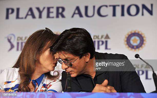 Owner of Mumbai Indians Neeta Ambani and Bollywood actor and owner of Kolkatta Knight Riders Shah Rukh Khan speak during a a postplayers' auction...