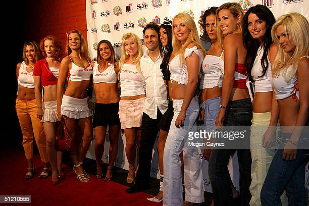 Owner of Palms Hotel and Casino George Maloof with 'Palm Girl' contestants as they arrive at the Palms Girl Competition on August 20 2004 at Club Xes...