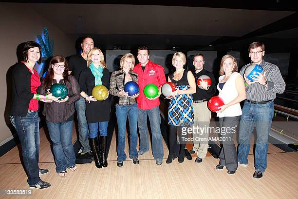 Owner of Papa John's Pizza John Schnatter and his team pose at the 2011 Amercian Music Awards Charity Bowl PreParty for American Red Cross at Lucky...