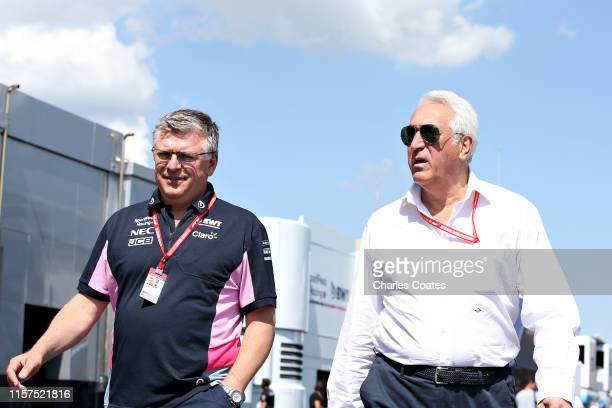 Owner of Racing Point Lawrence Stroll and Otmar Szafnauer Team Principal and Chief Executive Officer of Racing Point walks in the Paddock before...