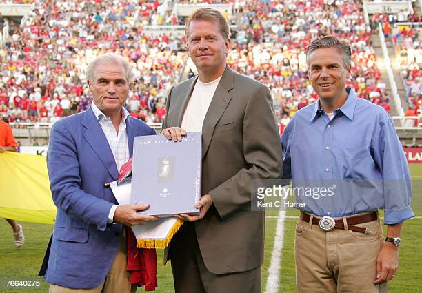 Owner of Real Salt Lake David Checketts, center, exchanges gifts with Real Madrid's President Calderon, left, and Utah Governor John Huntsman Jr....