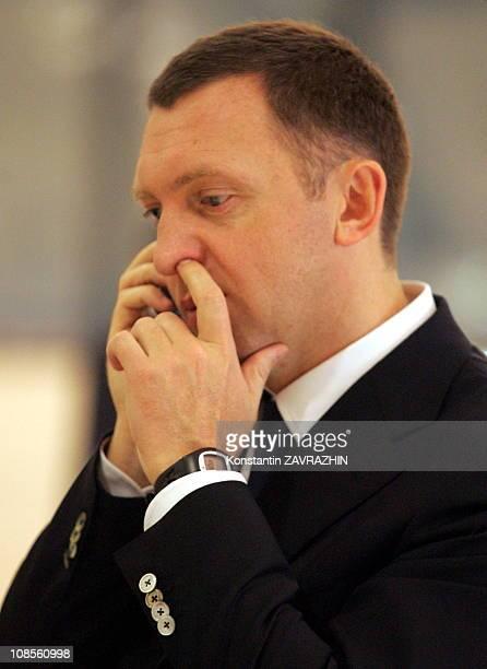 Owner of Russia's OAO Rusal billionaire and metals mogul Oleg Deripaska speaks by a cell phone at the APEC leaders summit in HanoiVietnam Oleg...