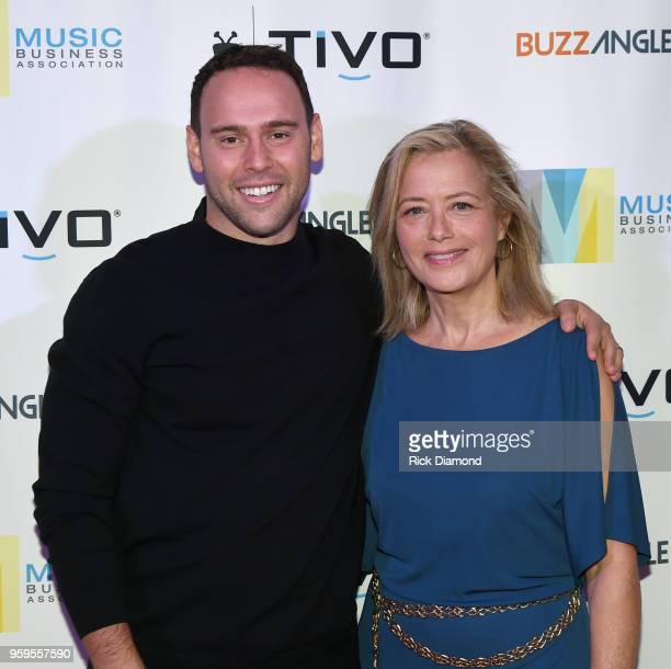 Owner of School Boy Records and RBMG Scooter Braun Hilary Rosen take photos before the Music Biz 2018 Awards Luncheon for the Music Business...