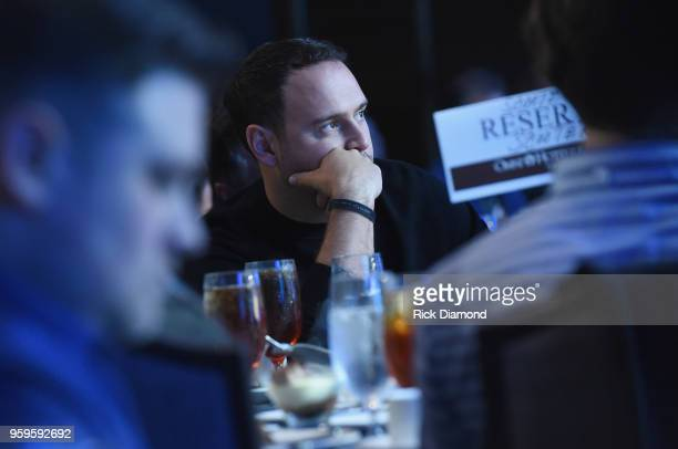 Owner of School Boy Records and RBMG Scooter Braun watches a video during the Music Biz 2018 Awards Luncheon for the Music Business Association on...