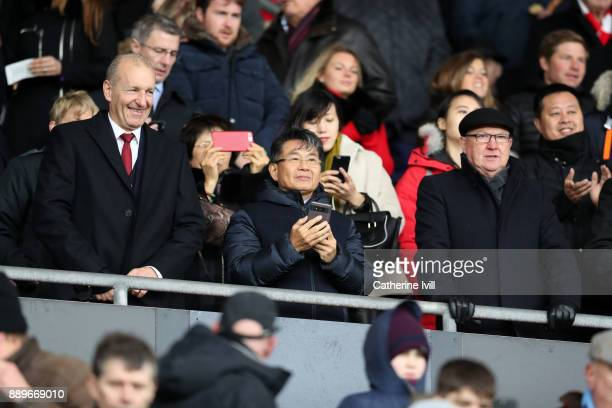 Owner of Southampton Gao Jisheng stands with Chairman Ralph Krueger and head of football development Les Reed during the Premier League match between...